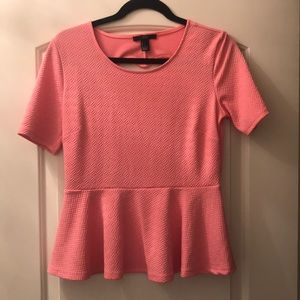 Pink top with heart shaped cutout in the back